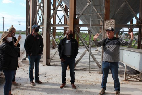 Evergreen FS Grain Department Manager, Todd McTaggert (right), explains the grain drying process to Ag Day participants.