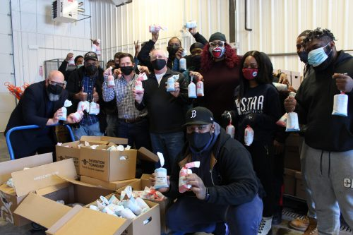 Volunteers at Thornton Township Food Pantry in Harvey, Ill. helped unload more than 300 pounds of frozen ground pork and frozen ground beef donated by McLean County Farm Bureau in partnership with Bloomington Meats.